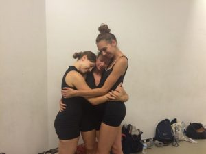 Kaleidoscope Dance Theatre Company-In-Training Members Jessica Davis and Sarah Warren embrace KDT Apprentice Jill Michalsky (center), in a candid moment mid rehearsal.  These are ties that bind!